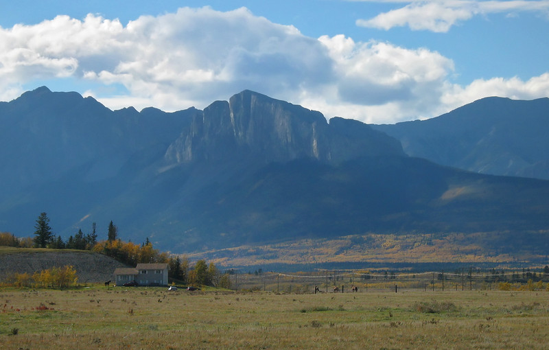 View approaching the Rockies beyond prairie ranch<br /> West of Calgary, Alberta, Canada