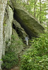 Hiker on the Tanawha Trail <br /> Under the Linn Cove Viaduct of the Blue Ridge Parkway, NC