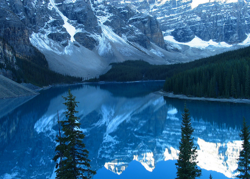 Moraine Lake as sun starts hitting Mountains of the Valley of the Ten Peaks<br /> Banff National Park, Alberta, Canada