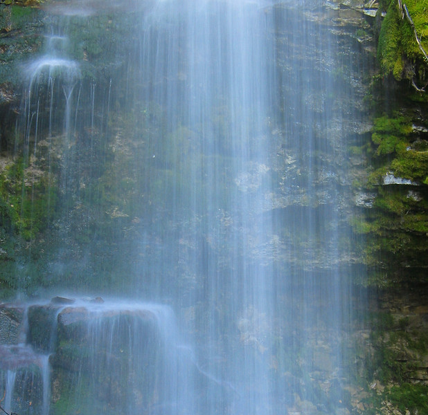 Troll Falls autumn trickle over moss-covered rocks<br /> Kananski Country, Alberta, Canada