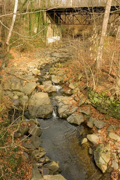 Minnehaha Creek flowing under old trolley trestle<br /> Glen Echo Park, Glen Echo, MD