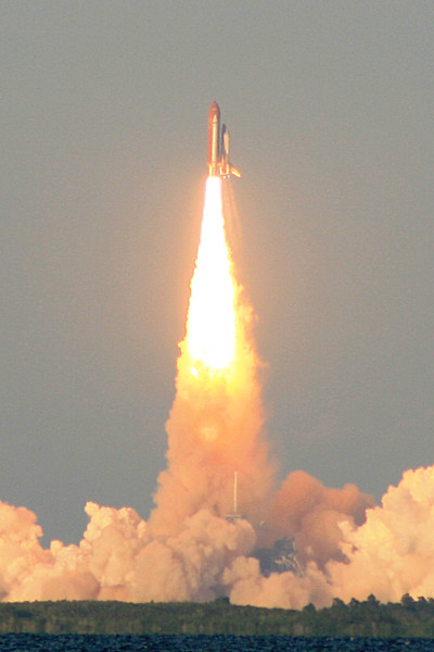 STS-117. Space Shuttle Atlantis LIFTOFF! Taken from Titusville aprox. 10 miles from the launch pad with 300mm lens.