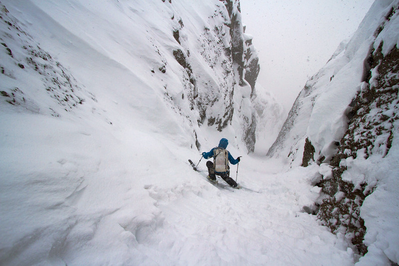 Beau Fredlund enjoying a narrow couloir descent in the Absaroka Mountains, Montana.