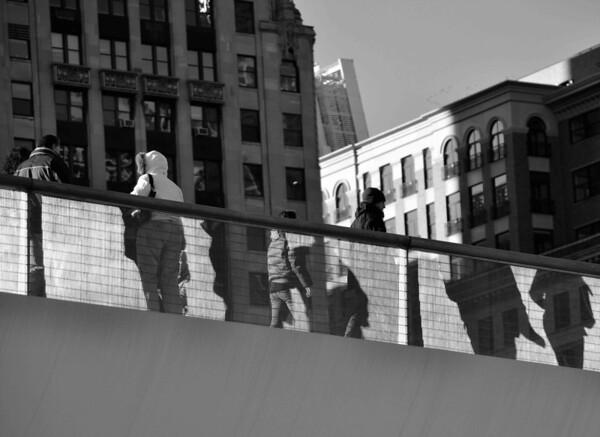 Shadow People on Walkway