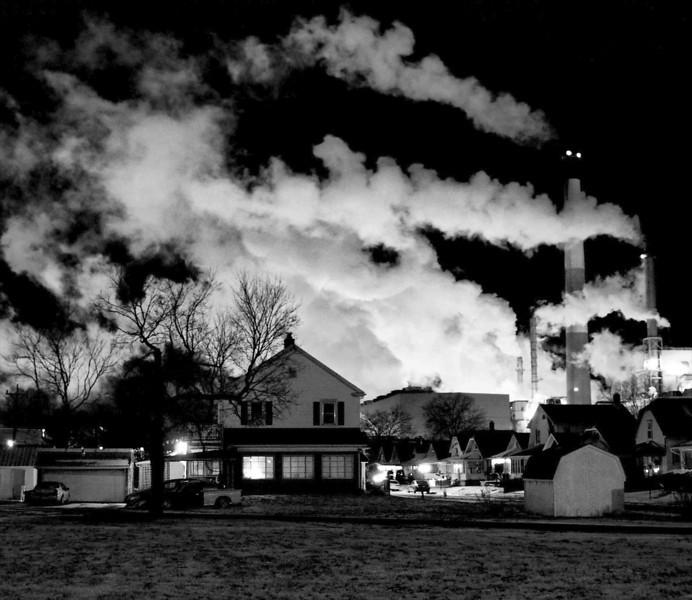 Mill Smoke Over Houses