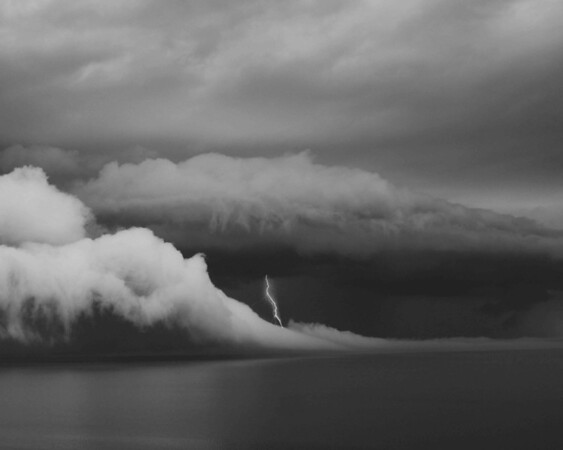 Lightning Strike and Cold Vent Cloud on Lake Erie