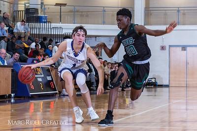 Broughton boys varsity basketball vs Enloe. January 4, 2019. 750_1216