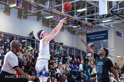 Broughton boys varsity basketball vs Enloe. January 4, 2019. 750_1249