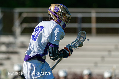 Broughton varsity lacrosse vs Enloe. April 23, 2019. D4S_9262