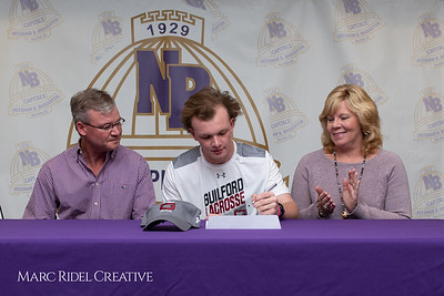 Broughton senior Austin Rohweder signs his commitment letter to play lacrosse for Guilford college. February 7, 2019. 750_2889
