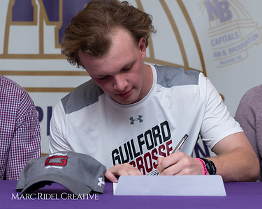 Broughton senior Austin Rohweder signs his commitment letter to play lacrosse for Guilford college. February 7, 2019. 750_2892
