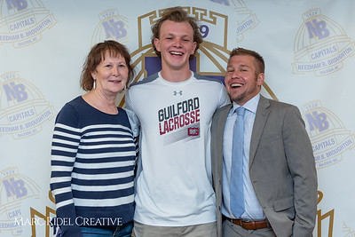 Broughton senior Austin Rohweder signs his commitment letter to play lacrosse for Guilford college. February 7, 2019. 750_2943