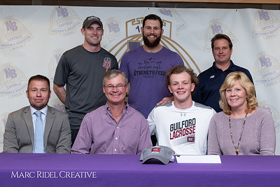 Broughton senior Austin Rohweder signs his commitment letter to play lacrosse for Guilford college. February 7, 2019. 750_2901