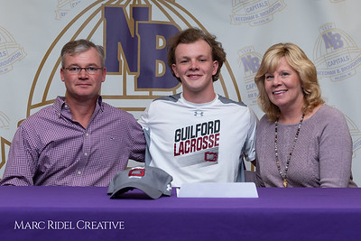 Broughton senior Austin Rohweder signs his commitment letter to play lacrosse for Guilford college. February 7, 2019. 750_2898