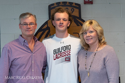 Broughton senior Austin Rohweder signs his commitment letter to play lacrosse for Guilford college. February 7, 2019. 750_2921