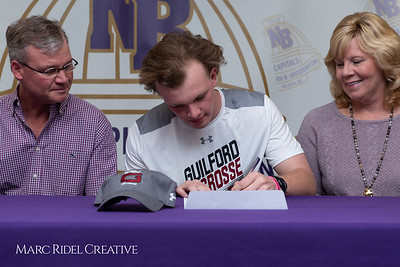 Broughton senior Austin Rohweder signs his commitment letter to play lacrosse for Guilford college. February 7, 2019. 750_2891