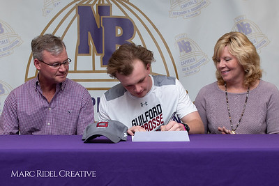 Broughton senior Austin Rohweder signs his commitment letter to play lacrosse for Guilford college. February 7, 2019. 750_2890