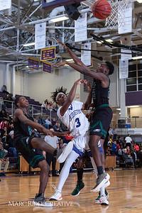 Broughton boys varsity basketball vs Enloe. January 4, 2019. 750_1193