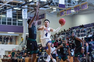 Broughton boys varsity basketball vs Enloe. January 4, 2019. 750_1278