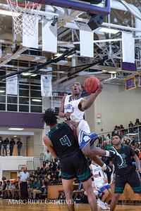 Broughton boys varsity basketball vs Enloe. January 4, 2019. 750_1261