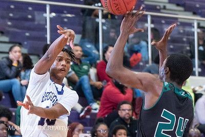Broughton boys varsity basketball vs Enloe. January 4, 2019. 750_1234
