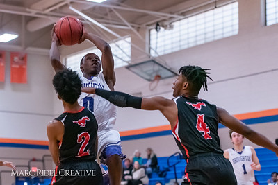 Broughton boys varsity basketball vs Middle Creek. January 21, 2019. 750_5257