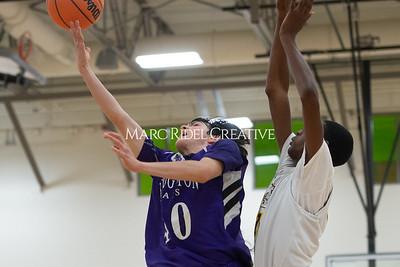 Broughton JV and varsity boys basketball at Apex. December 4, 2019. D4S_0892