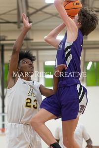 Broughton JV and varsity boys basketball at Apex. December 4, 2019. D4S_0917