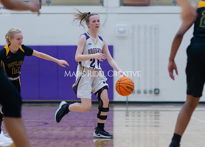 Broughton Lady Caps varsity basketball vs Enloe. December 17, 2019. D4S_8719