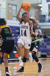 Broughton Lady Caps varsity basketball vs Enloe. December 17, 2019. D4S_8683