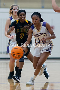 Broughton Lady Caps varsity basketball vs Enloe. December 17, 2019. D4S_8648
