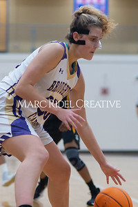 Broughton Lady Caps varsity basketball vs Enloe. December 17, 2019. D4S_8679