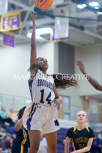 Broughton Lady Caps varsity basketball vs Enloe. December 17, 2019. D4S_8686