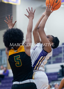 Broughton Lady Caps varsity basketball vs Enloe. December 17, 2019. D4S_8737
