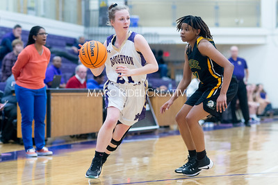 Broughton Lady Caps varsity basketball vs Enloe. December 17, 2019. D4S_8661