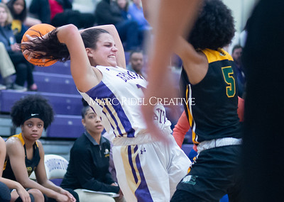 Broughton Lady Caps varsity basketball vs Enloe. December 17, 2019. D4S_8744
