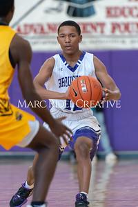 Broughton basketball vs Farmville Central. December 26, 2019. D4S_1178