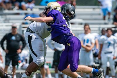 Broughton football pre-season scrimmages at South Garner high school. August 11, 2018.