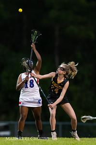Broughton Lady Caps varsity lacrosse at Sanderson. March 22, 2019. D4S_2741