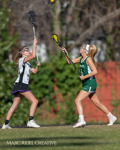 Broughton JV Lady Caps lacrosse vs Cardinal Gibbons. March 19, 2019. D4S_1182