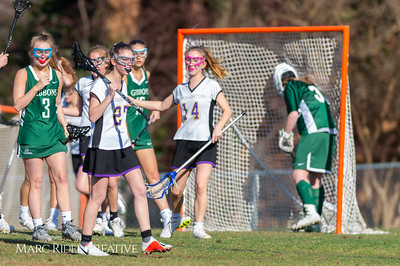 Broughton JV Lady Caps lacrosse vs Cardinal Gibbons. March 19, 2019. D4S_1104