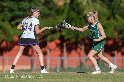 Broughton JV Lady Caps lacrosse vs Cardinal Gibbons. March 19, 2019. D4S_1149