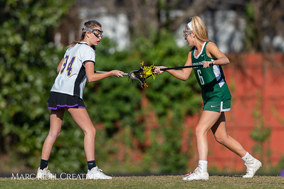 Broughton JV Lady Caps lacrosse vs Cardinal Gibbons. March 19, 2019. D4S_1180