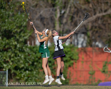 Broughton JV Lady Caps lacrosse vs Cardinal Gibbons. March 19, 2019. D4S_1185