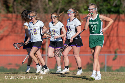 Broughton JV Lady Caps lacrosse vs Cardinal Gibbons. March 19, 2019. D4S_1106
