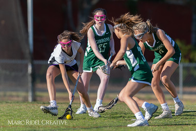 Broughton JV Lady Caps lacrosse vs Cardinal Gibbons. March 19, 2019. D4S_1197