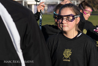 Broughton varsity Lady Caps lacrosse vs Cardinal Gibbons. March 19, 2019. MRC_4572