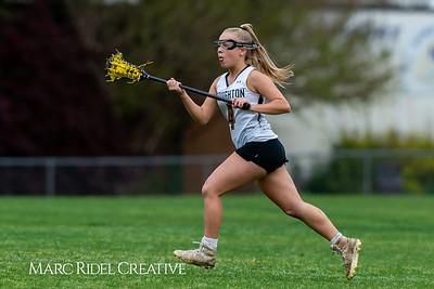 Broughton Lady Caps varsity lacrosse vs Leesville. April 9, 2019. D4S_4272