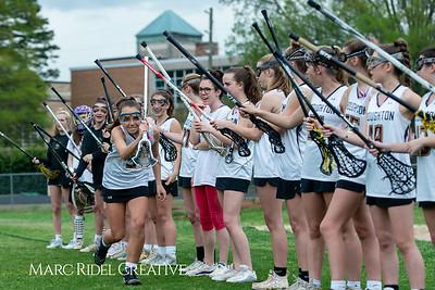 Broughton Lady Caps varsity lacrosse vs Leesville. April 9, 2019. D4S_4118