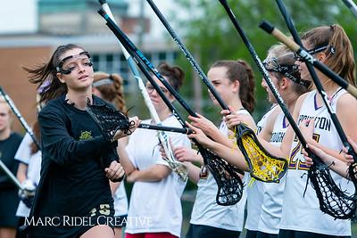 Broughton Lady Caps varsity lacrosse vs Leesville. April 9, 2019. D4S_4173